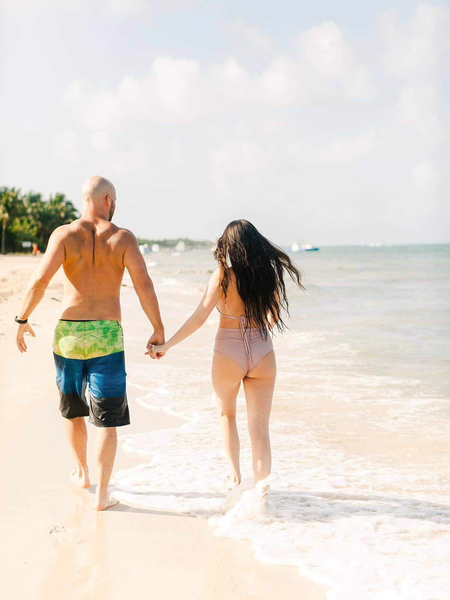 husband wife in bathing suits in Caribbean waters